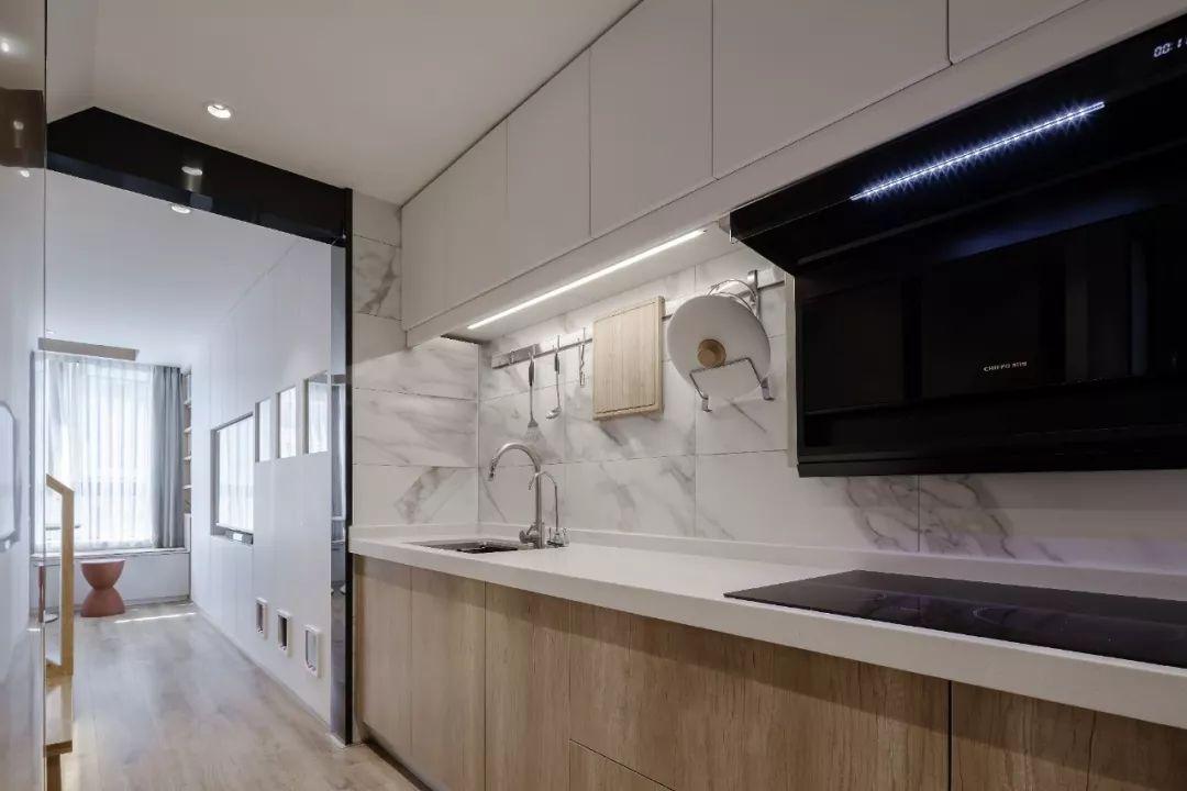 36㎡簡約風躍層單身公寓,過道加入收納柜更實用!-4