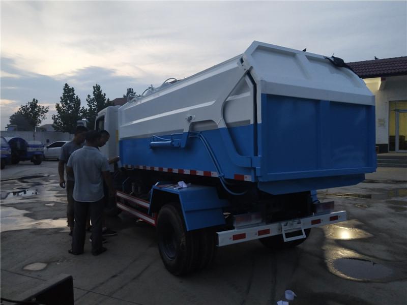 挂桶垃圾车-e98653a42f37bd1c2bb5657203efd1b