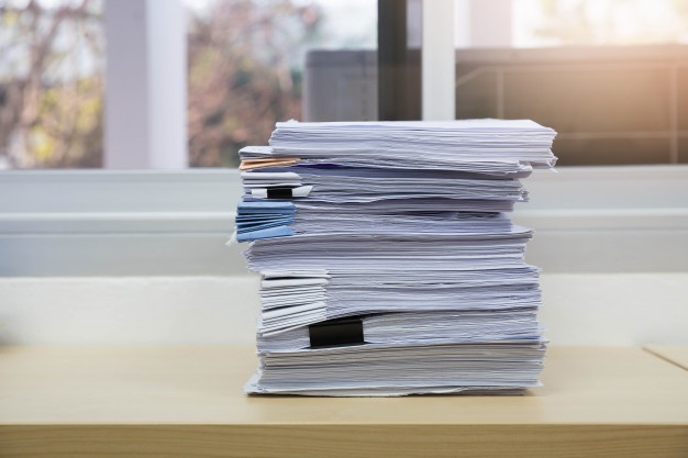 pile-unfinished-documents-office-desk-stack-business-paper_35892-311