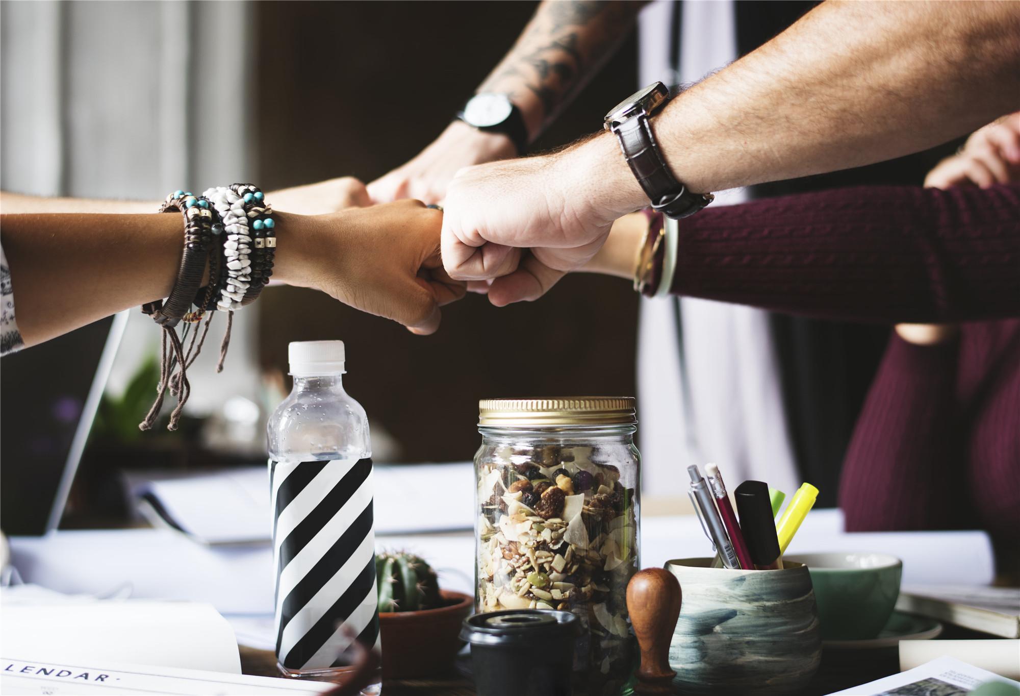 colleagues-cooperation-fist-bump-fists-71f42f94d286f295478f6b3e65e46574
