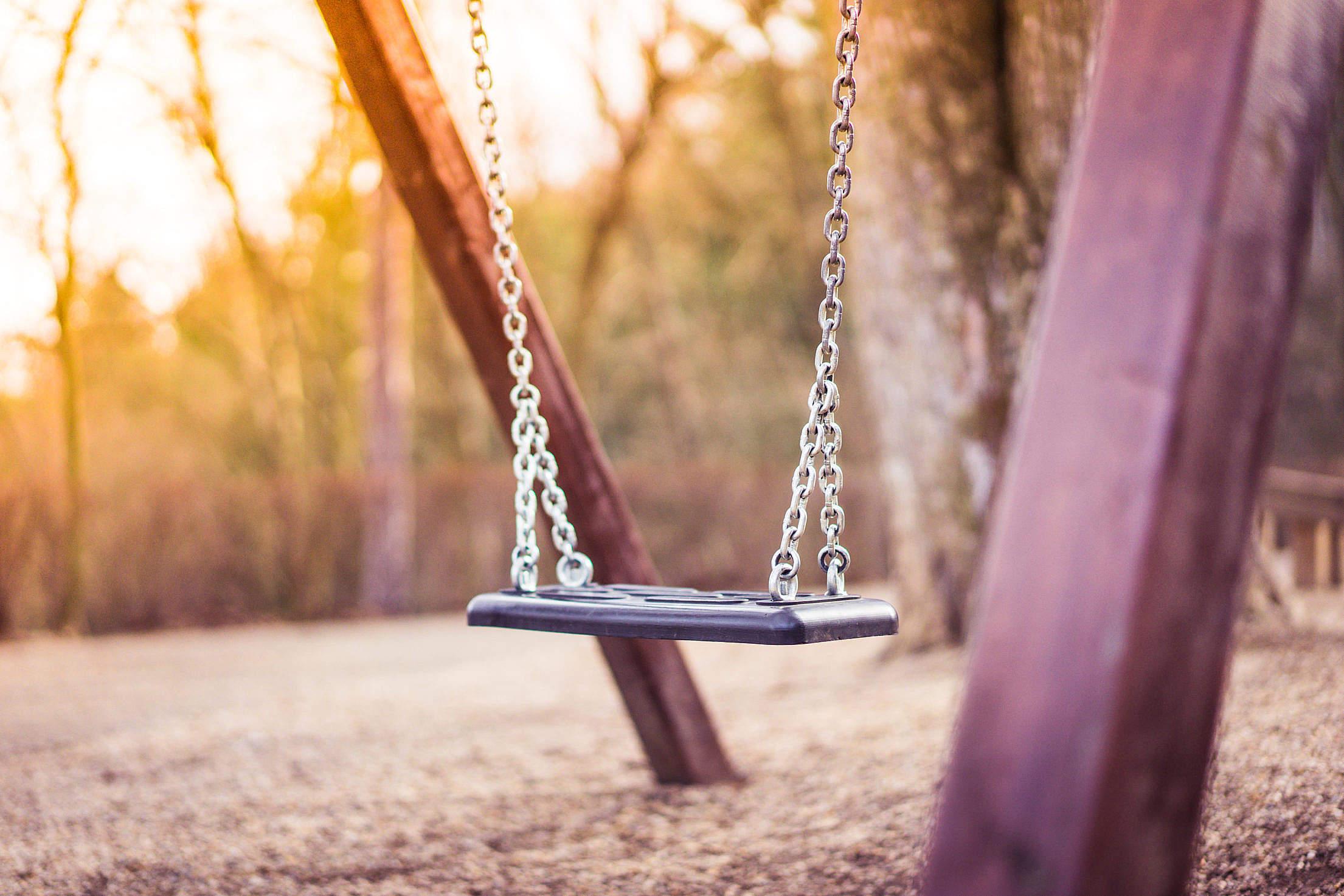 swing-for-kids-in-city-park-playground-2_free_stock_photos_picjumbo_DSC03309-2210x1474