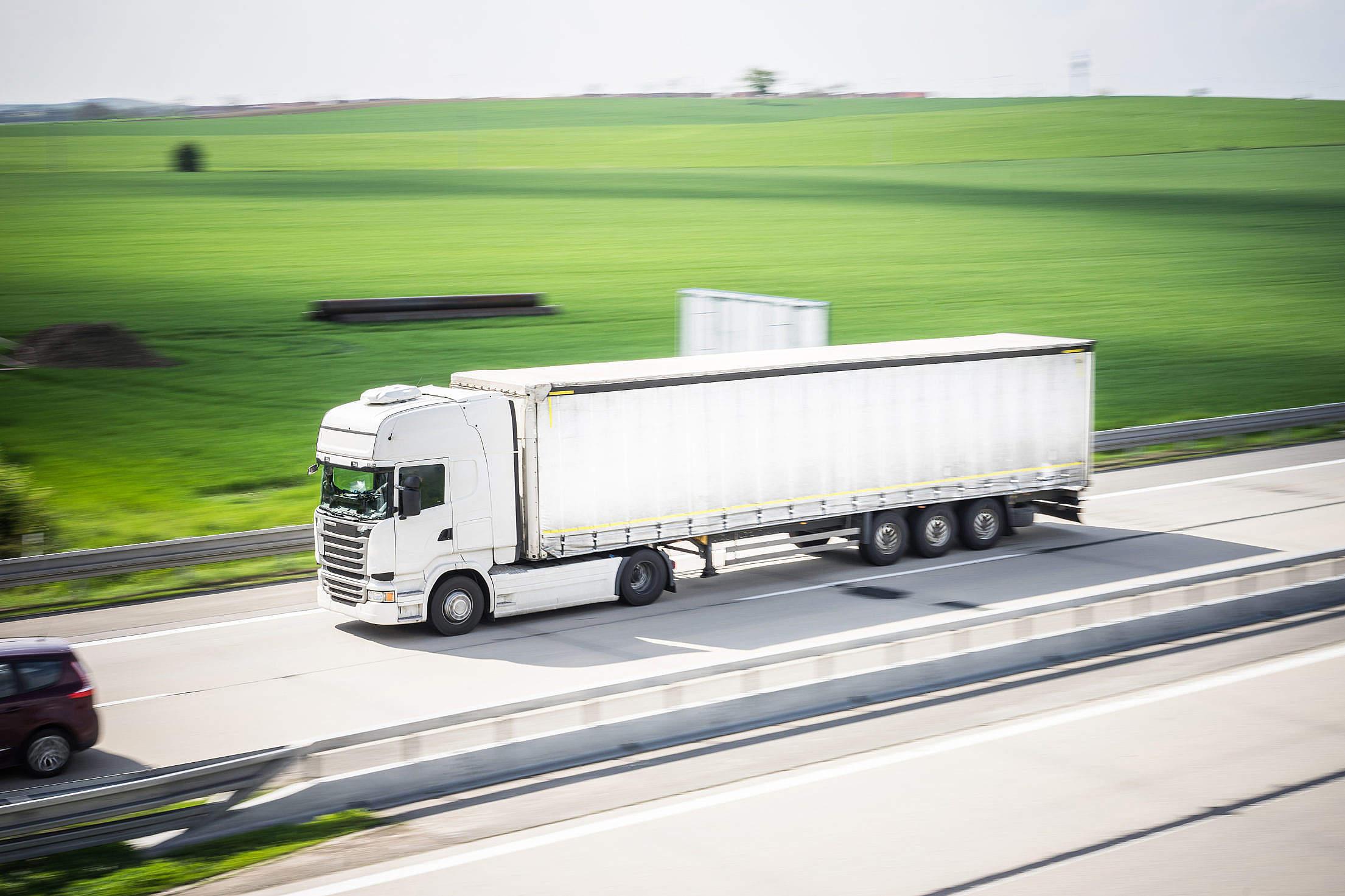 white-tir-truck-in-motion-driving-on-highway_free_stock_photos_picjumbo_DSC04205-2210x1473