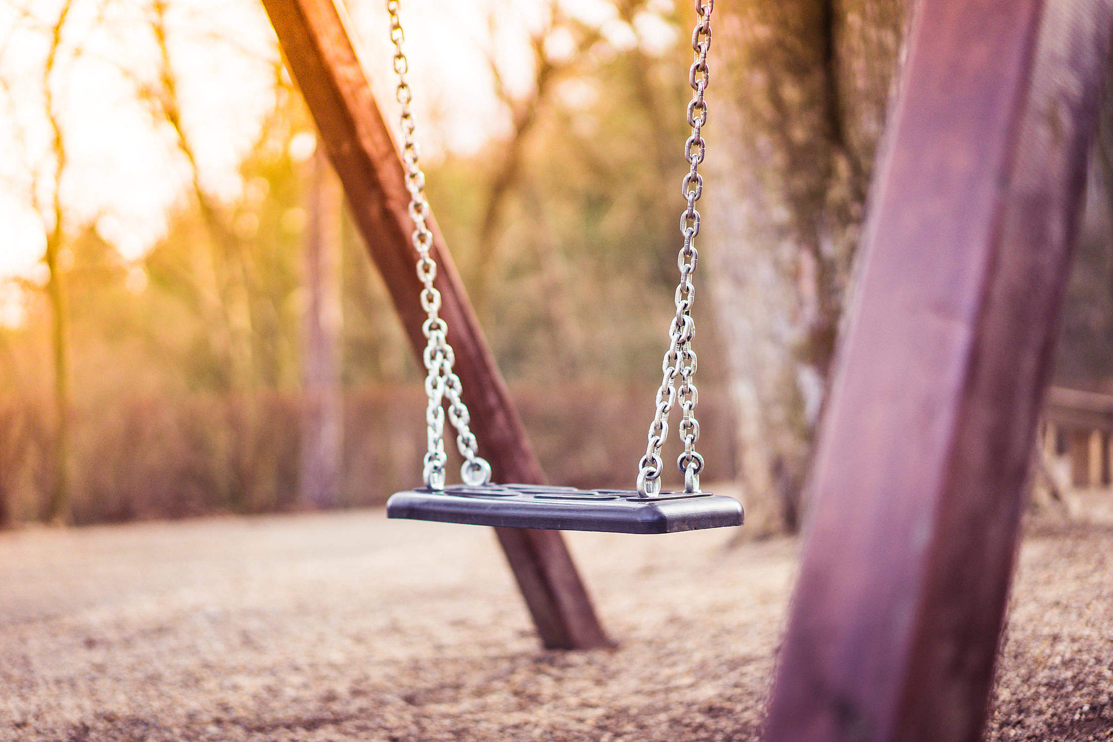 swing-for-kids-in-city-park-playground-2_free_stock_photos_picjumbo_DSC03309-2210x1474